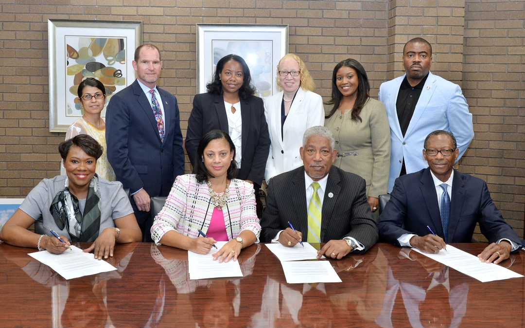 Southern University System officials and CIA representatives sign the historic MOU between agencies.