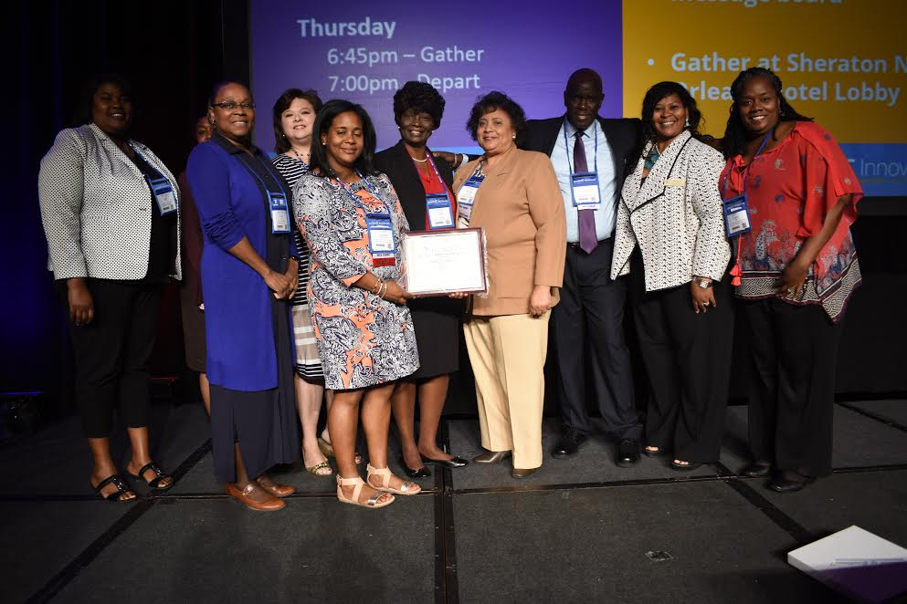 From Left to right: Dawn Ventress Kight (J. B. Cade Library), Ms. Reshonda Corley (Research Assistant SMED), Ms. Marier Piper (SMED doctoral student – SUBR), Dr. Susanah Craig (SMED SUBR), Dr. Francesca Williams (SMED, SUBR – holding Award), Ms. Loretta Spruel (SMED doctoral student – SUBR), Dr. Veronica McEachin (SUSLA Direct. Online Learning), Dr. Moustapha Diack (Chair SMED), Dr. Sharron Y. Herron-Williams, Vice Chancellor for Academic Affairs, SUSLA, Dr. Cynthia Bryant (Dean -College of Humanities and Interdisciplinary Studies, SUBR)