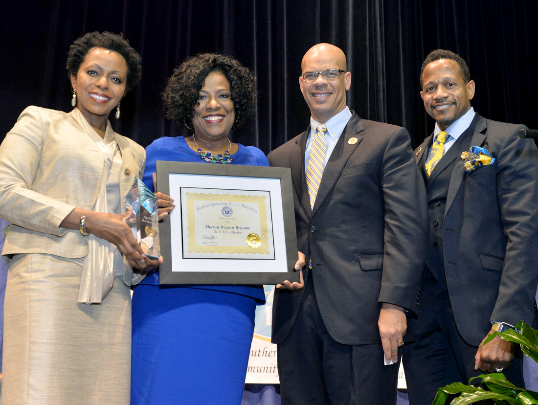Sharon Weston Broome, the first female elected mayor-president of Baton Rouge-East Baton Rouge Parish, was the keynote speaker for the Community Prayer Brunch and Southern University Founders' Day Convocation, March 9, 2017, in the F.G. Clark Activity Center. Pictured is Mayor Broome (second from left) receiving an honorary SU Alumni Federation (SUAF) Life Membership from (left – right) Robyn Merrick, executive associate, SU System President; attorney Preston Castille, SUAF president; and Derrick Warren, director, alumni affairs, SU System and SUAF executive director.