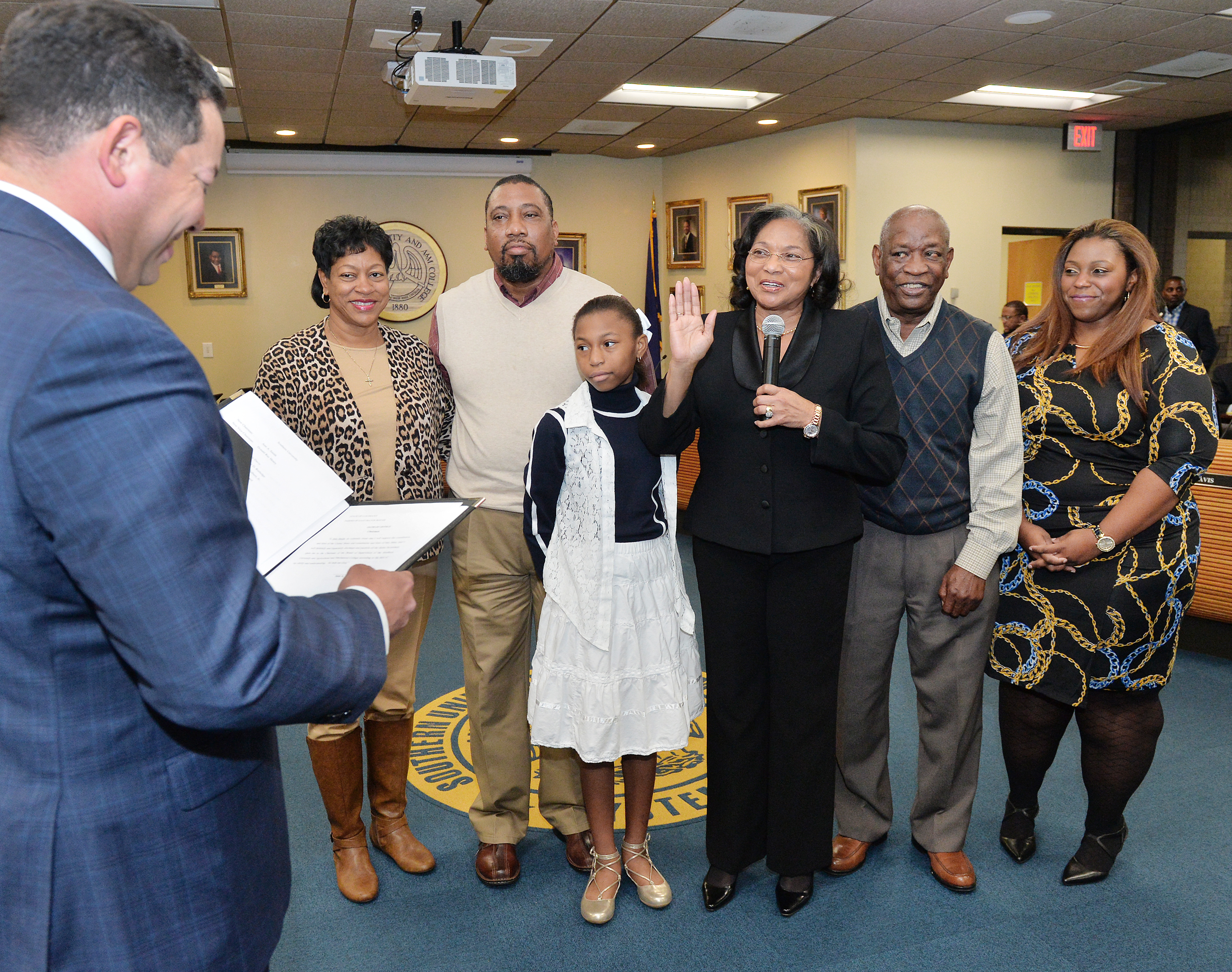 Southern University Board of Supervisors chairwoman Ann A. Smith is installed during the governing board's regular meeting January 6, 2017, in Baton Rouge. SU Board of Supervisors general counsel Winston Decuir Jr. administers the oath of office. Pictured (left to right) are:  EBR School Board Member Vereta Lee, Steven Smith, Hannah Smith, Ann A. Smith, Harold Smith, and Joi Smit