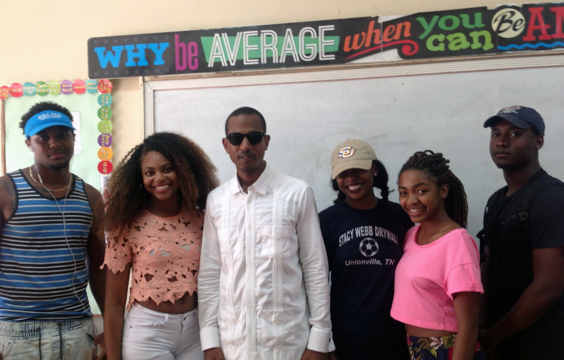 A group of SU Baton Rouge students recently returned from a three-week study abroad program in Belize, Central America. Pictured at Wesley Junior College in Belize are (left to right) SUBR students Jeremiah West and Alana Stevenson, international rap artist Shyne, and SUBR students Raven Buntyn, Janae McGee, and Zachary Williams. —Photo Eric Pugh.