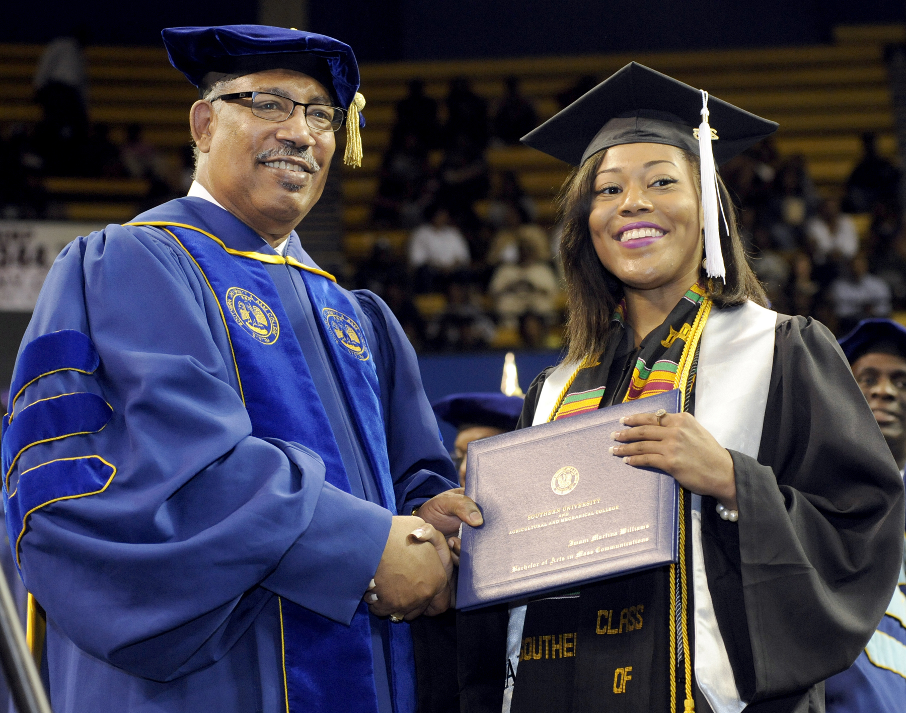Southern University System President-Chancellor congratulates West Palm Beach, Florida native, Imani Martina Williams, who had the highest grade point average of the undergraduate students who received degrees during fall commencement at Southern University Baton Rouge, Friday, December 11, 2015.