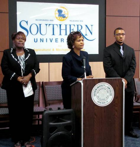 "Dr. Verjanis Peoples, Chair of the SU College of Education, speaks to the audience during the April 14 press conference annoucing the new ""Cradle to College"" Partnership between the Advance Baton Rouge Charter School Association and Southern University's College of Education. Standing with Dr. Peoples are (from left) Dwana Webb, director of Professional Development Schools/Field Experience with the College of Education and Peter Mars, SU Senior Physical Education major"
