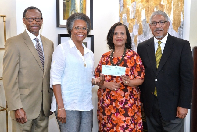 Dr. Denise Pearson (2nd from left), VP Academic Affairs & Equity Initiatives at SHEEO, presents SUBR's Dr. Verjanis Peoples with check to advance the work of Project Pipeline Repair, which aims to increase representation of men of color in the teaching profession. Dr. James Ammons, executive vice president/ executive vice chancellor (far left) and Dr. Ray Belton, Southern University president (far right) were also present.