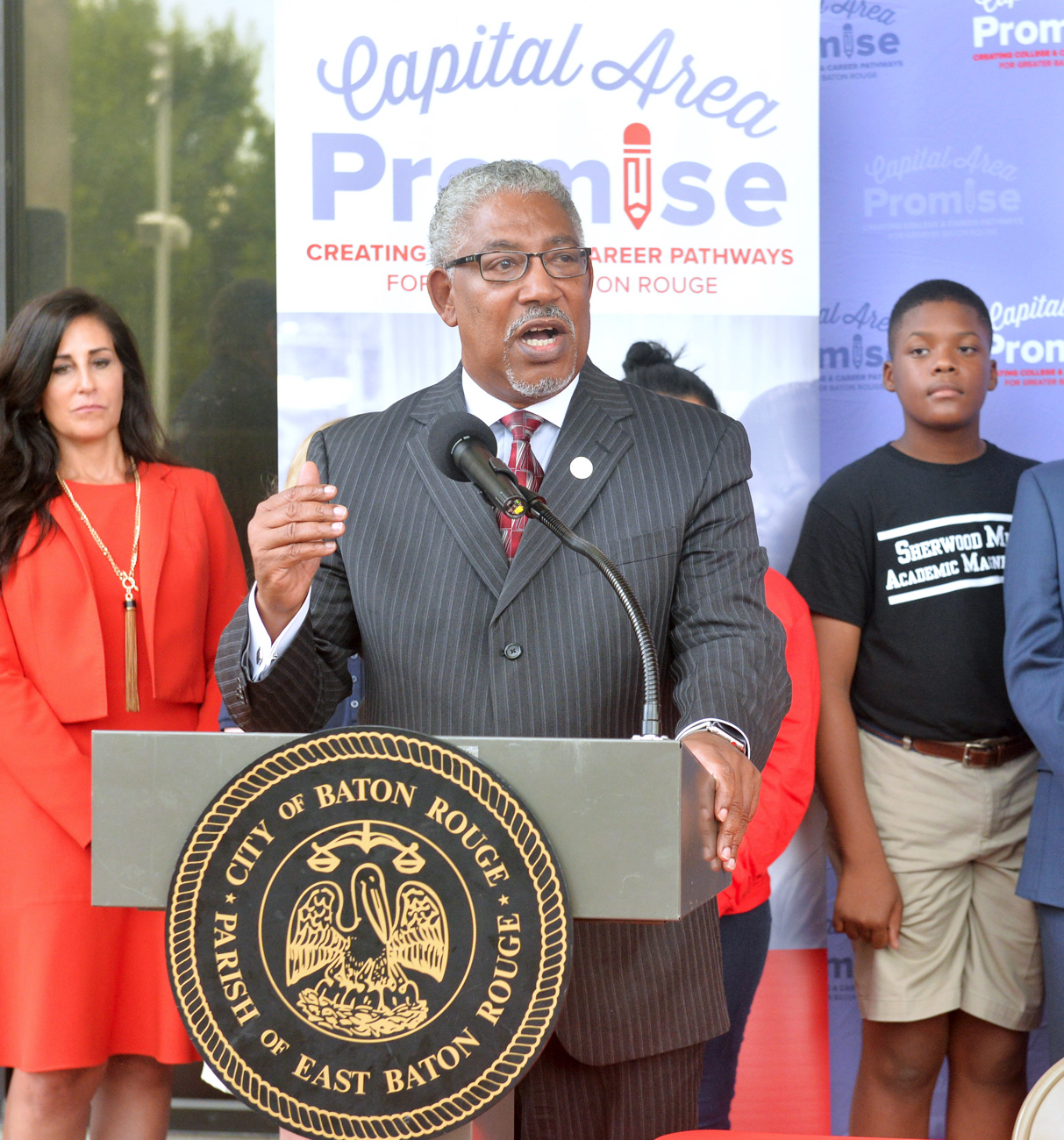 Ray L. Belton addresses the audience at the Capital Area Promise press conference